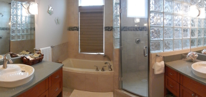 Dual vanity with jacuzzi tub and walk-in shower in custom home master bath