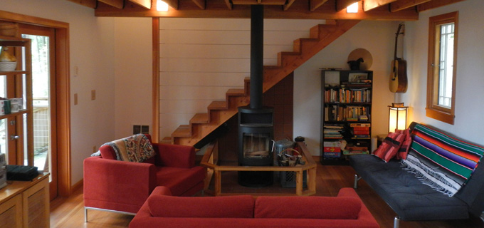Custom Guemes cabin interior with European-style wood stove